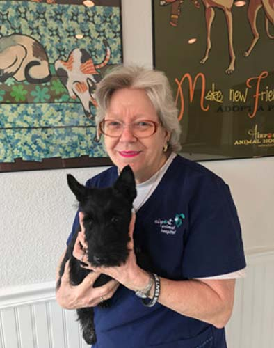 Dog Grooming expert, Ms. Jan holds a cute black Scottie dog